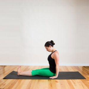 Yoga pose to cure sciatica. Staff pose or dandasana.