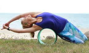 Yoga poses with yoga wheel- Side bend on wheel