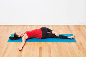 Lying spinal twist-Yoga pose for pregnant moms to ease morning sickness.