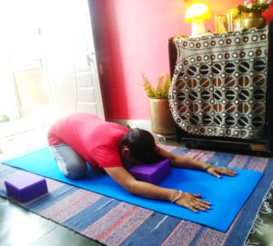 Child's pose with yoga blocks