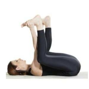 Happy baby yoga posture
