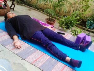 Savasana after doing yoga Bandha practice
