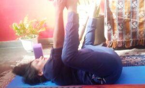 Balance your hormones with happy baby yoga posture